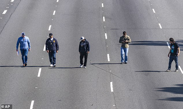 Police officers conducted a search along the freeway on Friday following the shooting