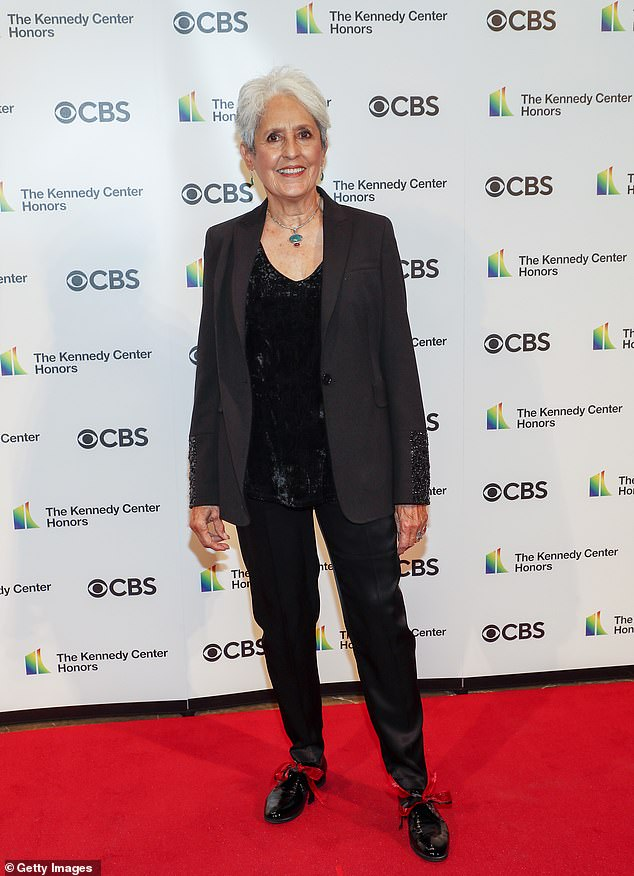 Laid back: Folk singer Joan Baez stuck to a more casual yet still formal look with a black blazer with sparkling beads on the cuffs and matching pants, along with a black velvet top