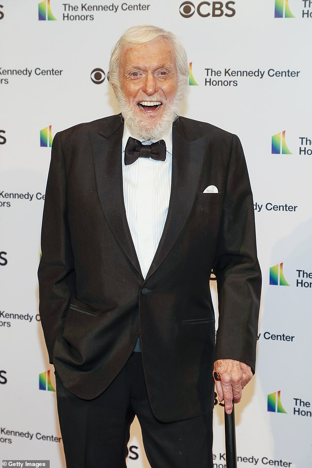 Old school:The Mary Poppins star sported an infectious smile with plenty of laughter as he arrived on the red carpet in a classic black tuxedo