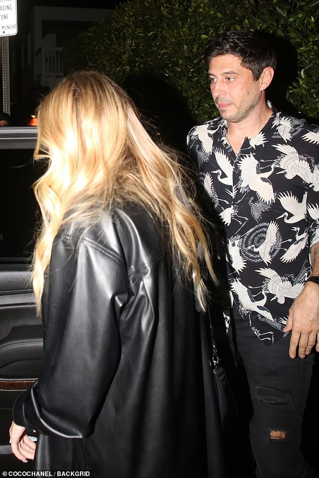 Dapper: Petra teamed her all-black leather look with a black camisole while her fiancé Sam Palmer, 38, looked dapper sporting a sleeveless bird print shirt