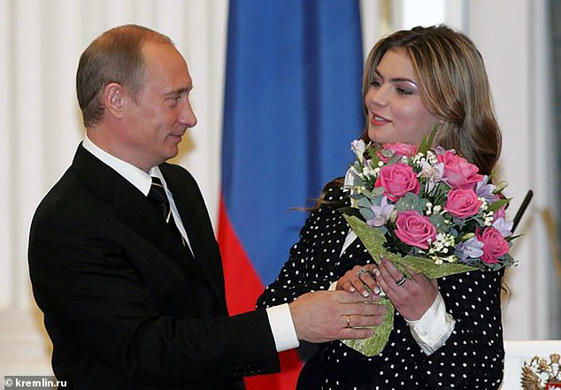 Glamorous Alina Kabaeva, the suspected lover of Vladimir Putin (both pictured), has made a rare public statement more than two-and-a-half years after she was last seen in public