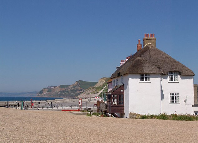 The Beach House in Dorset sleeps 20 people and situated right on the beach