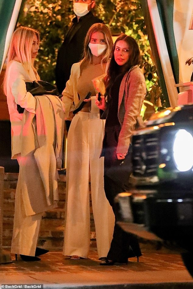Friends:The doting mother toted her belongings in a leather clutch and appeared deep in conversation as she kicked off the weekend in style