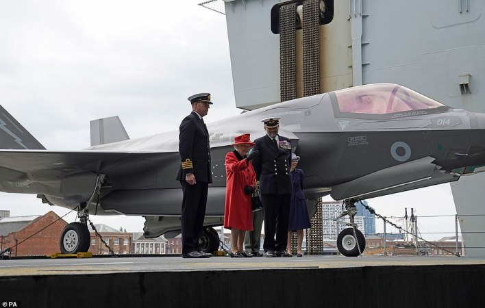 The Queen was greeted by the ship's commanding officer Captain Angus Essenhigh, and Commodore Stephen Moorhouse, commander of the UK Carrie Strike Group (CSG), as she arrived by helicopter on board the aircraft carrier at Portsmouth Naval Base.