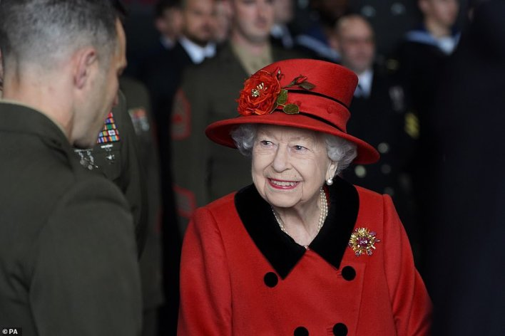The monarch wore a rouge button-up jacket with a matching bowler hat for the visit as well as a scarab brooch (pictured), which was gifted to her by her late husband Duke of Edinburgh