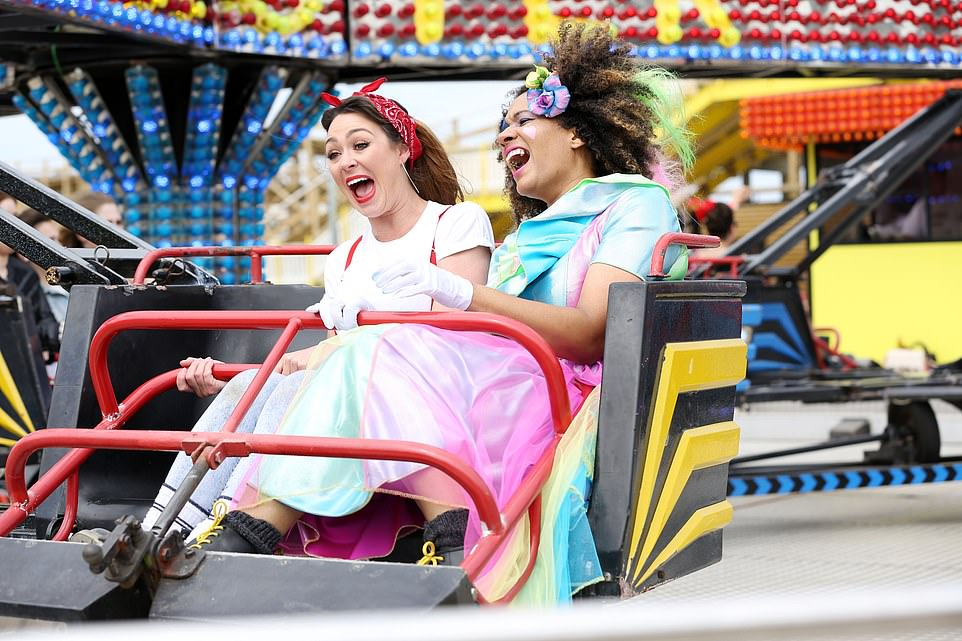 Fifties frills: Two friends enjoying a ride at Margate's retro funfair Dreamland, which is home to the UK's first wooden rollercoaster