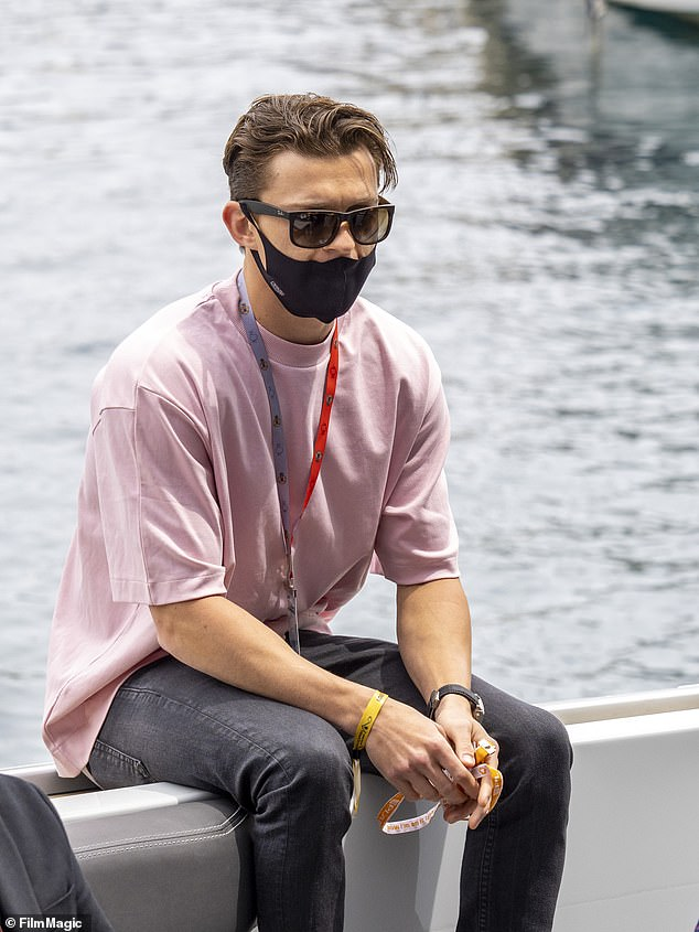 Laid back: The Spider-Man star looked effortlessly cool in a pair of black wayfarers and a matching face mask