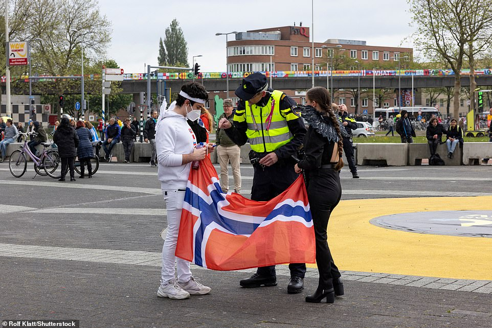 Fans carry their flags and wear face masks as they arrive to the Rotterdam Ahoy arena and prepare for the final