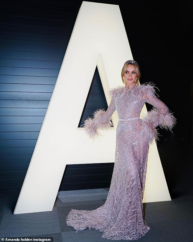 Glamorous: Amanda Holden was dolled to the nines for the Eurovision song contest on Saturday night in a lilac ball gown but came under fire after she attempted to speak Dutch