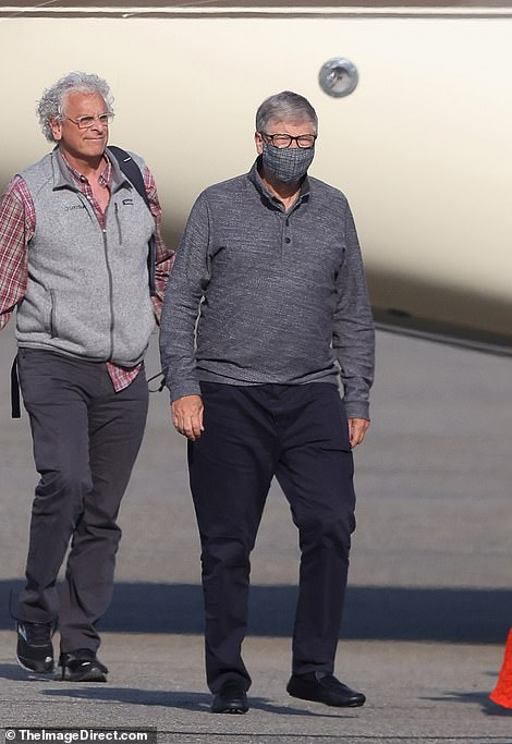 The man sported glasses, a check shirt and a bodywarmer