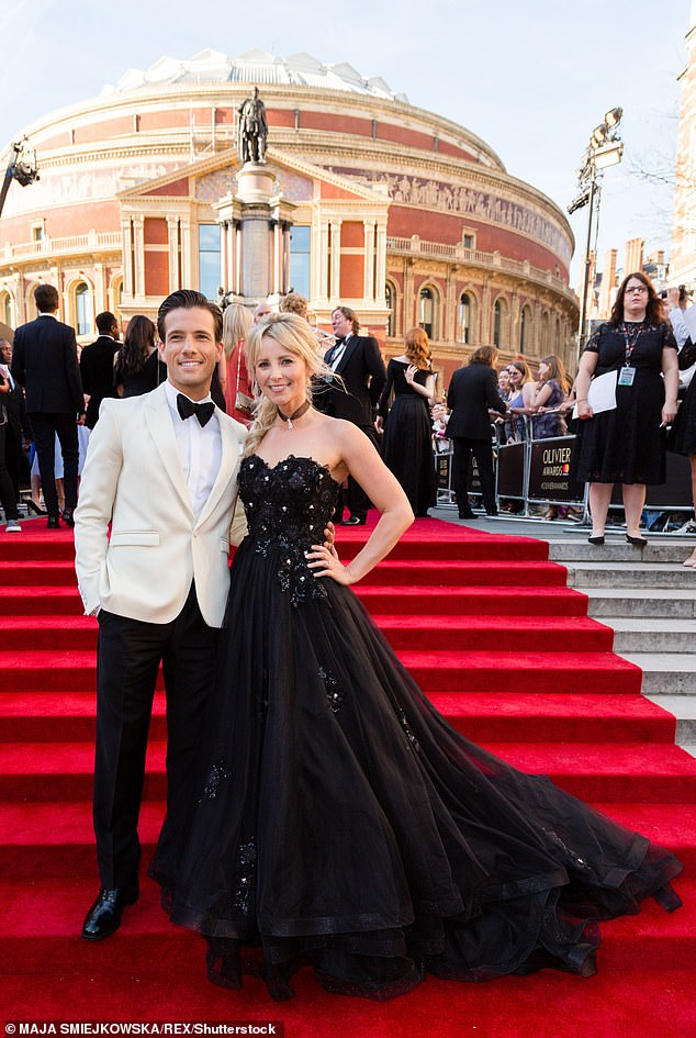 Candid:Danny Mac, 33, and his wife Carley Stenson, 38, don't have any baby arrival plans set in stone, with Carley hoping her husband 'gets [to the hospital] in time'(pictured in 2017)