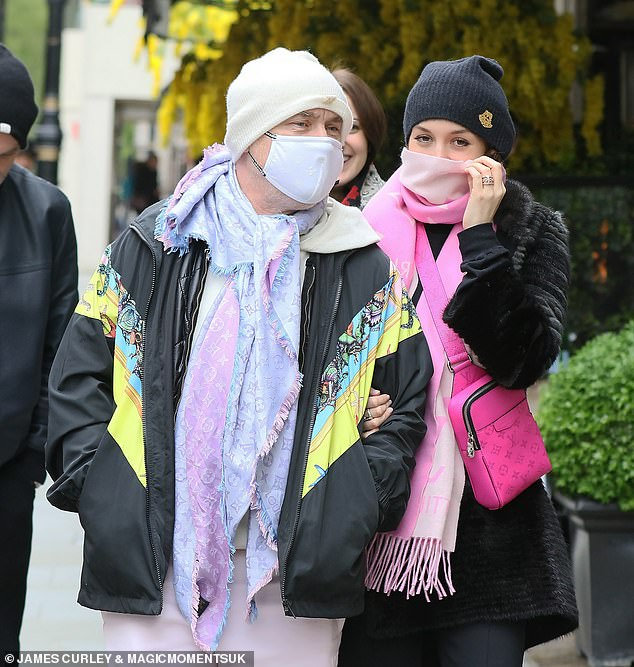 Precautions: They donned face masks while heading to Scott's