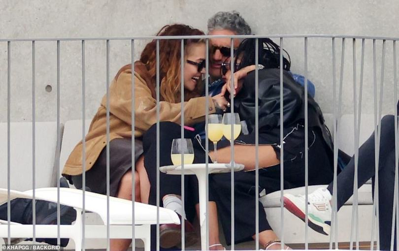Fun times: The women beamed with delight while Taika looked a little perplexed at their laughter