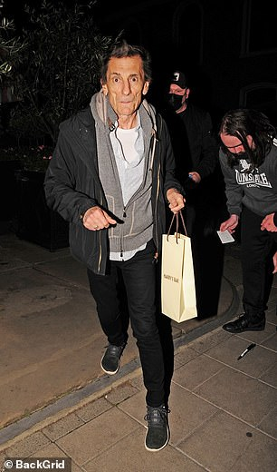 What's in the bag? Rocker Ronnie left the popular venue sporting a white bag, suggesting he had treated himself to a bottle of wine to take home