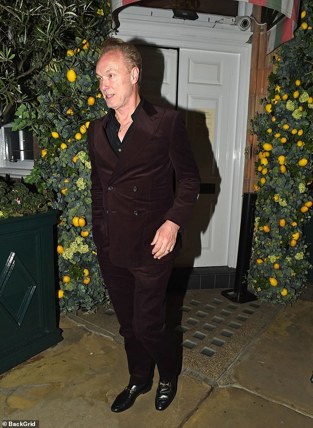 Fancy footwear: Unlike Mick and Ronnie - who both donned trainers - Gary opted for smart footwear, slipping into Gucci loafers