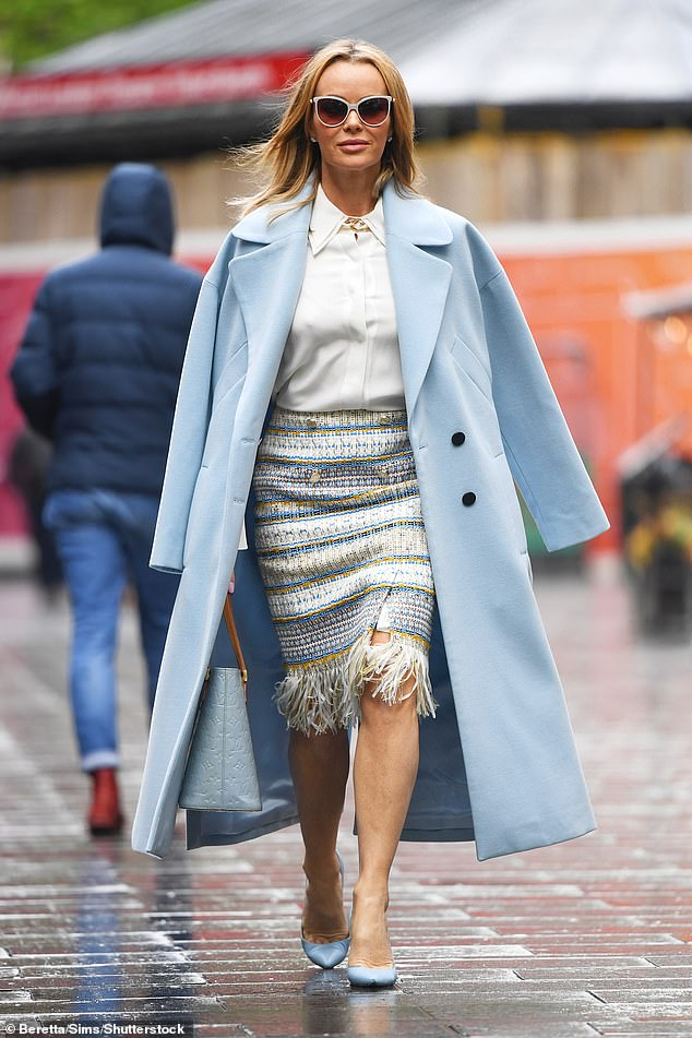 Stylish:Amanda Holden, 50, put on a chic display on Monday when she left Heart FM's London offices wearing a powder blue coat and a woven skirt
