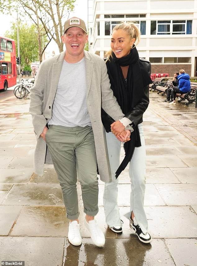 Happy:Jamie Laing, 32, and Sophie Habboo, 27, proved they're more loved up than ever on Monday when they stepped out in London for a romantic stroll