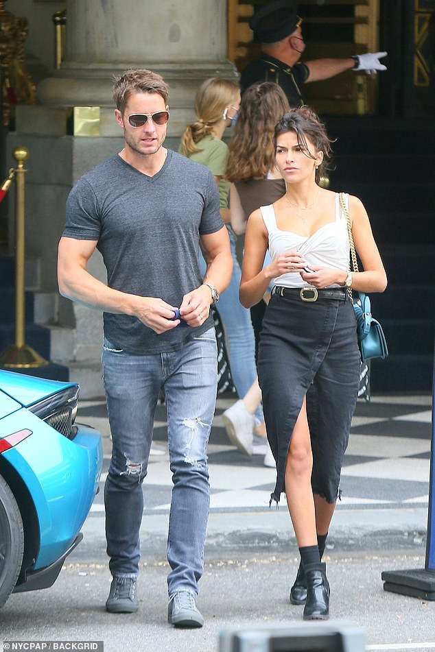 Form fitting: The former The Young and the Restless star, 31, donned a plunging white top with ruching around the bust along with a black denim midi skirt with black booties
