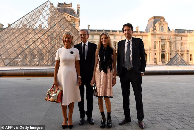 Bernard Arnault (pictured with wife Helene [left], their son Antoine and his spouse Natalia Vodianova) saw LVMH's stock increase by 0.4 per cent in first hours of trading on Monday