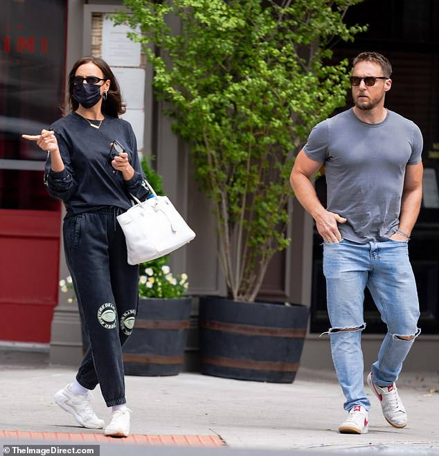 Let's hang: Irina Shayk was spotted meeting up with her personal trainer Jason Walsh in New York on Monday