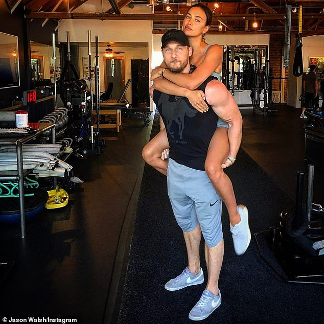 Workout pals: Jason shared this photo of him and Irina back in October