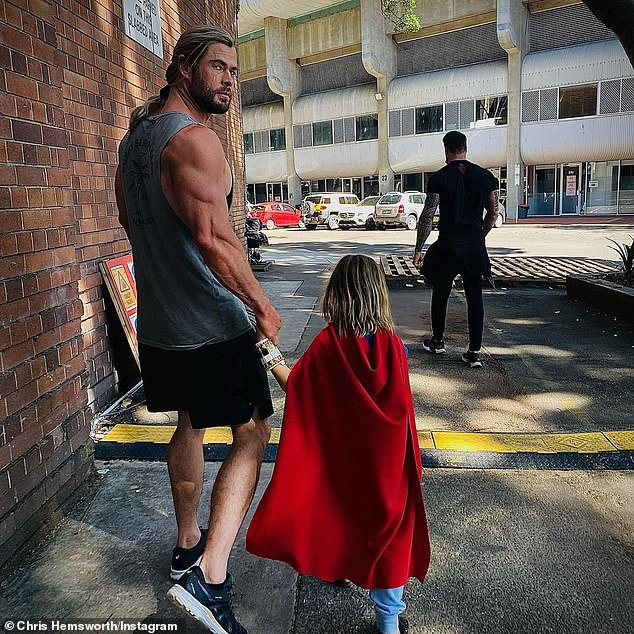 Problem child: Chris Hemsworth is the face of Marvel's Thor, but that doesn't mean much to his seven-year-old son, who hilariously confirmed his allegiance to DC's Superman on Tuesday
