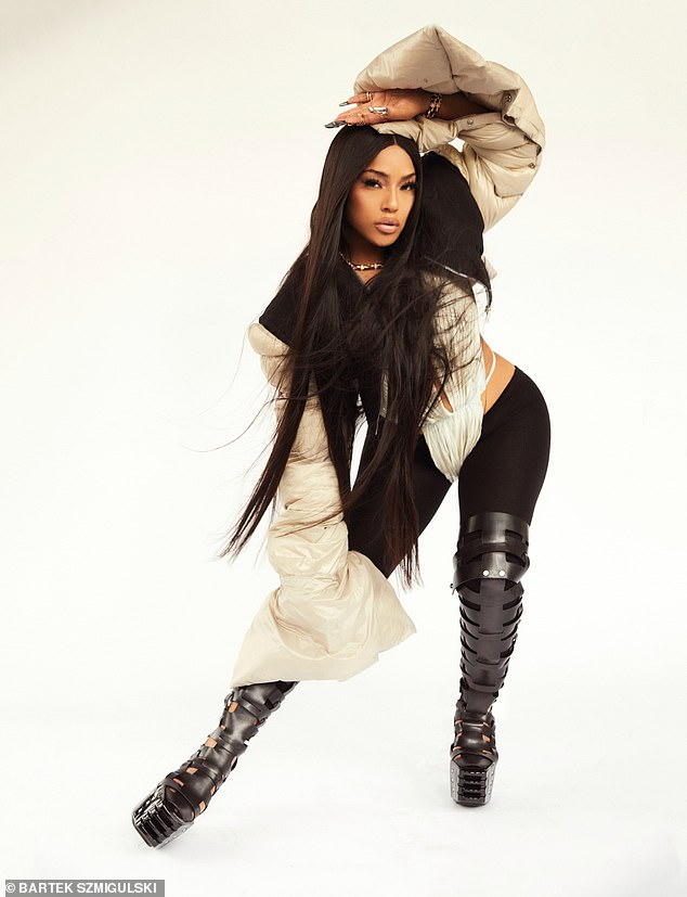 Legs for days! In one snap, Stefflon wored in a pair of edgy black strap thigh-high boots that she wore over a pair of black leggings