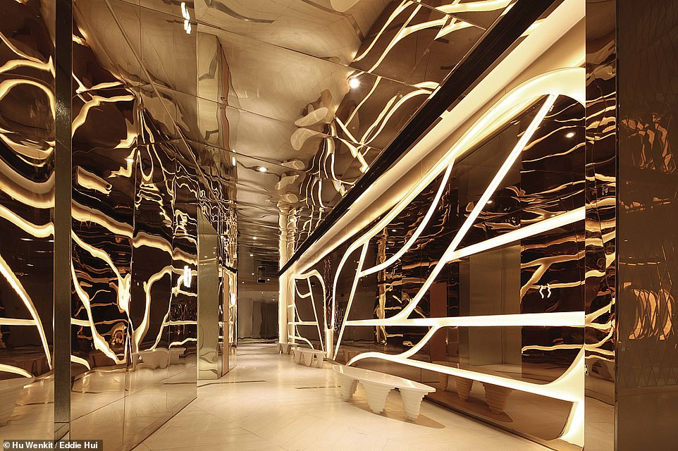 FUTURE AMAZON CINEMA, HUIZHOU, CHINA: This photograph displays one of the corridors at the Future Amazon cinema. In the book, Wong says: 'Future Amazon symbolises the beginning of a groundbreaking cinema chain for the 21st century as well as the genesis of a film oasis with a surprisingly refreshing energy'