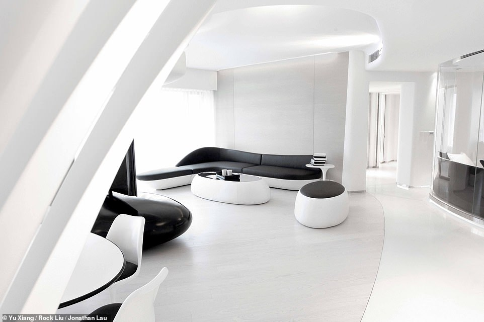 HOUSE OF WHITE APARTMENT, HONG KONG: Here, the living room at The House of White is revealed from a different angle. To the right of the shot, behind the glass partition, is a comfy seating area called The Alcove