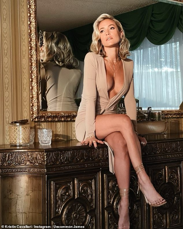 Ready to party:Kristin Cavallari shared a stunning pinup image on Tuesday morning. The Hills: New Beginnings guest star wore a caramel colored dress that showed off both her chest and legs as she reclined on a table while on a trip to Palm Springs, California