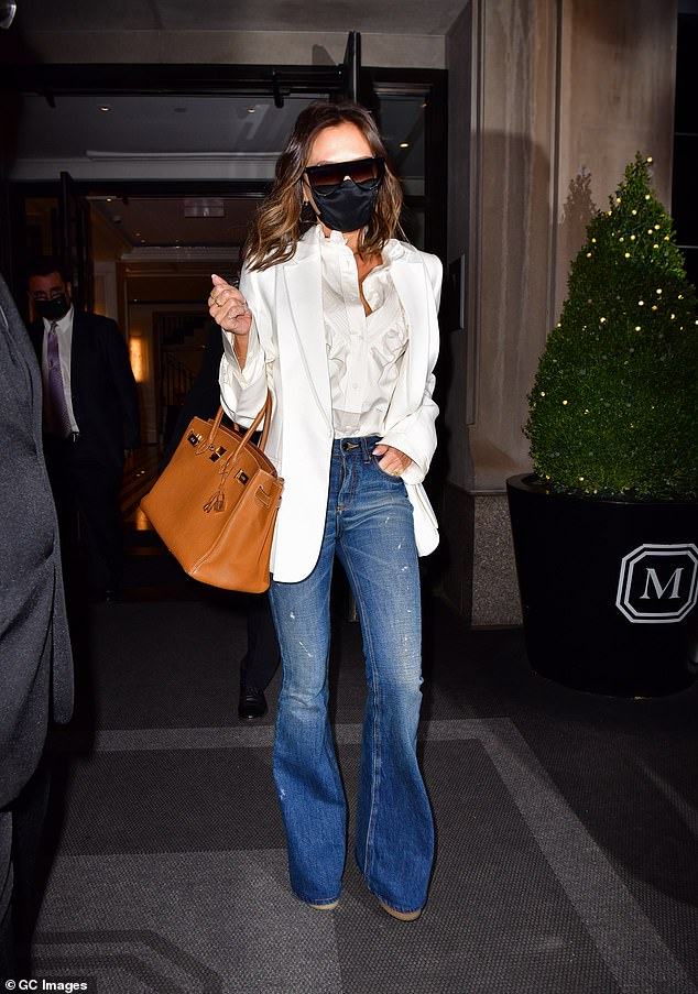 Earlier in the day: Victoria was seen in her date night outfit earlier in the day