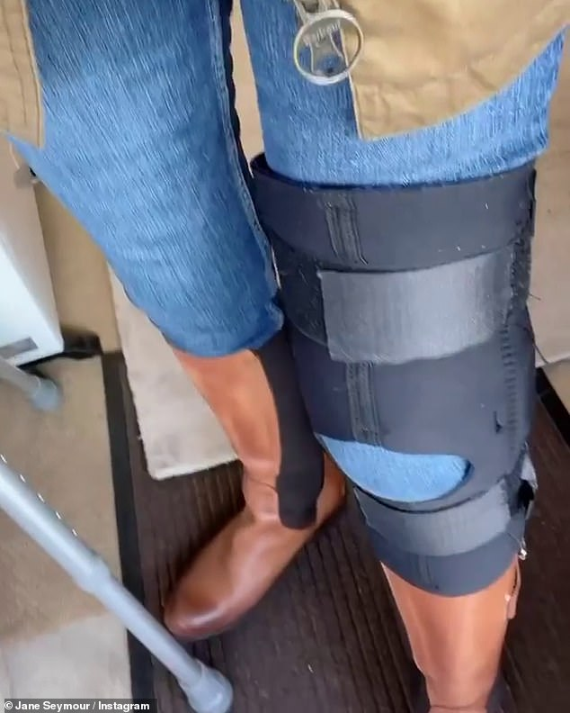 Oh dear:In a video shared to Instagram, Jane revealed she had injured her left kneecap after filming a thrilling scene that involved her running across a bridge