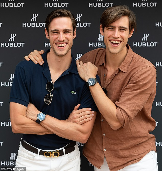PDA: The duo were seen passionately kissing and laughing as they enjoyed a stroll together in Sydney (Zac is pictured here with his twin brother,Jordan [left])
