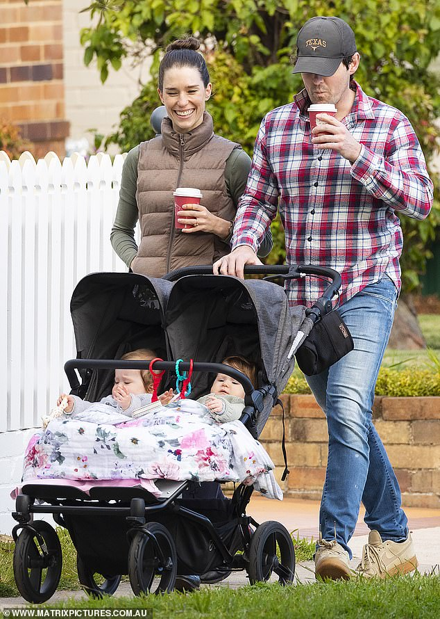 Family:Purple Wiggle Lachlan Gillespie and his fiancée Dana Stephensen looked every inch the doting parents as they took a stroll with their twins Lulu and Lottie in Sydney on Sunday
