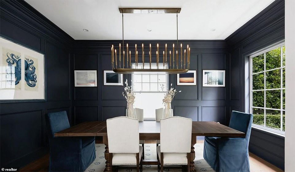 There's a formal dining room with a large chandelier and other amenities include a wine cellar and a separate 'pet room'