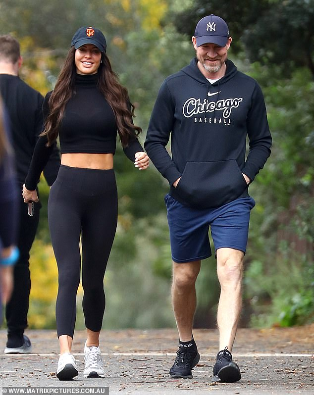 Making it official: Collingwood coach Nathan Buckley and his glamorous new girlfriend Alex Pike were pictured together for the very first time in Melbourne on Wednesday
