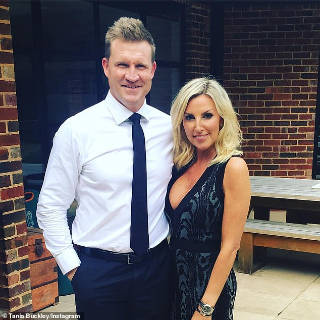 Over: Nathan's online friendship came just weeks after the Magpies coach and champion midfielder announced his split from his wife of 18 years, Tania Minnici (pictured together)