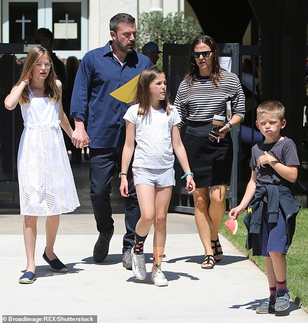 Co-parenting:The former couple share daughters Violet, 15, Seraphina, 12, and son Samuel; the family pictured in 2019