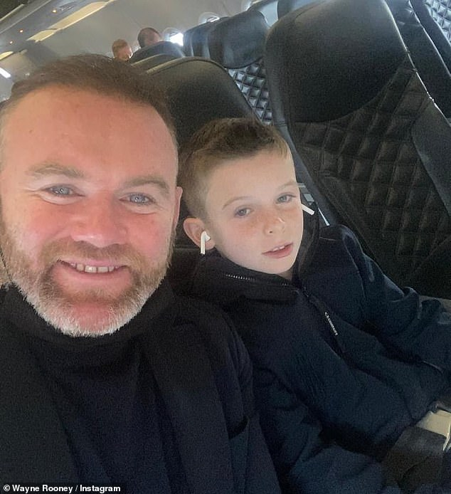 Flying visit: Wayne's former teamManchester United played Villareal in Poland last week, but lost on penalties (pictured with Klay on the flight)