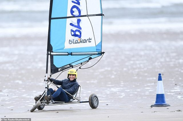 And she's off! Competitive Kate was in her element as she took on her husband in the land yacht race on the blustery beach