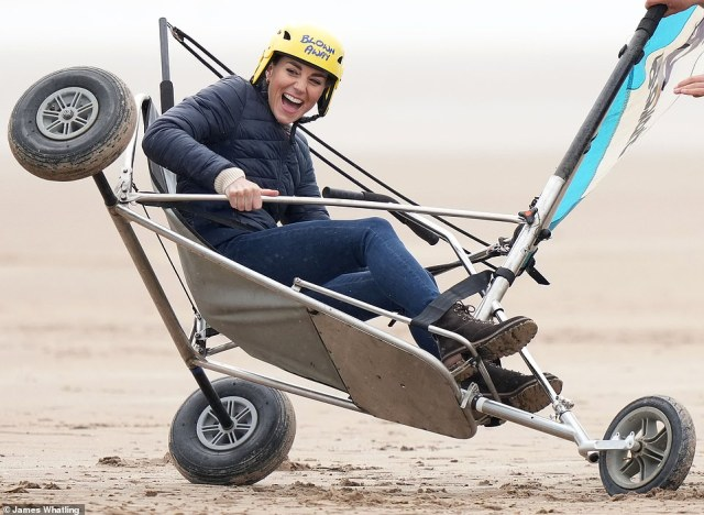 There she blows! The Duchess of Cambridge had her land yachting kart lifted off the sand in a safety demonstration