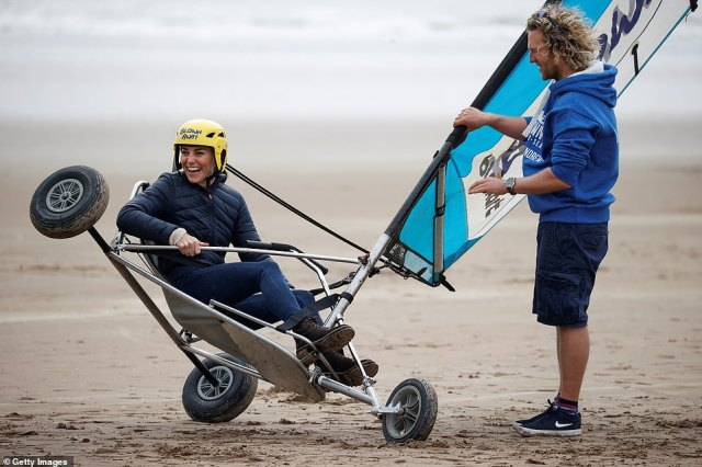 Don't topple over! Kate Middleton laughed as the instructor lifted up the Duchess in the safety demonstration