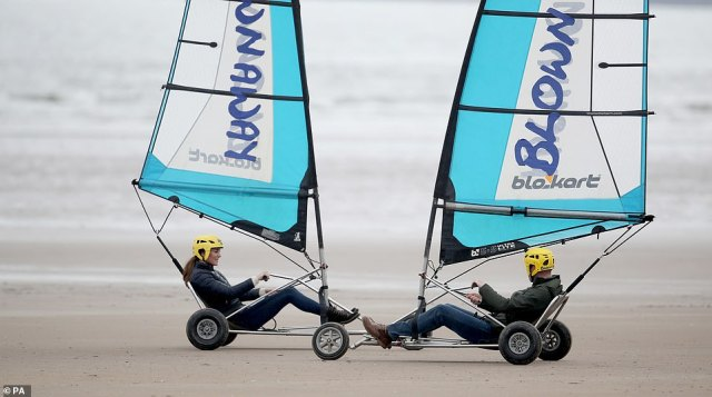 Getting close! The Duke and Duchess of Cambridge both tried their hand at the activity in St Andrews today