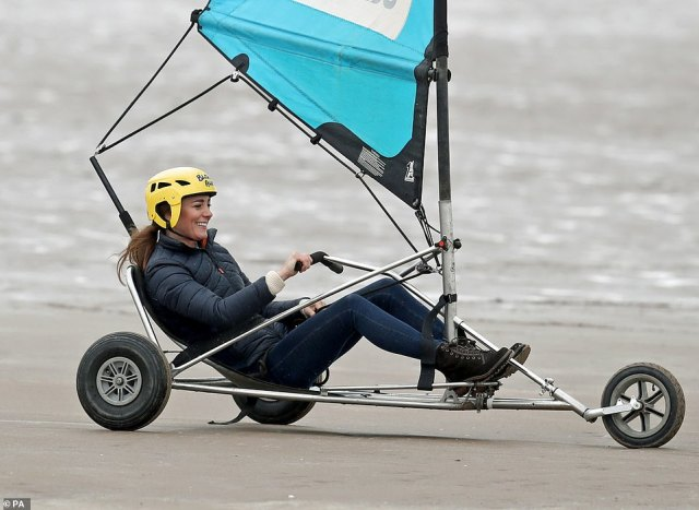 Getting the hang of things: The Duchess of Cambridge smiled as she set off down the beach in the land yacht