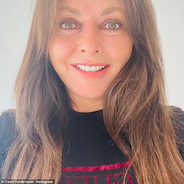 Designer garb: Carol beamed in a selfie as she showed off her black Gucci jumper