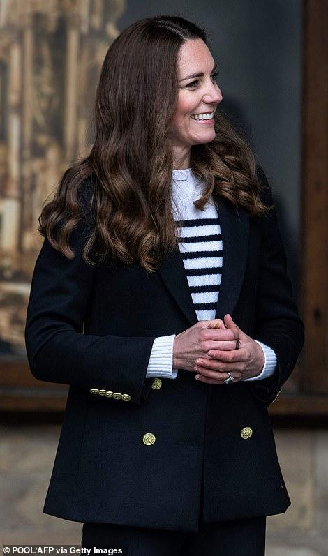 Polished: Kate was smartly dressed in a £650 striped Erdem jumper, £549 Jade Holland Cooper blazer and £90 Veja trainers