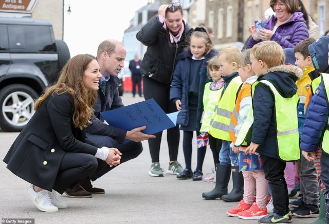 Plenty to say: The Duke and Duchess of Cambridge were presented with a folder of art by the young children