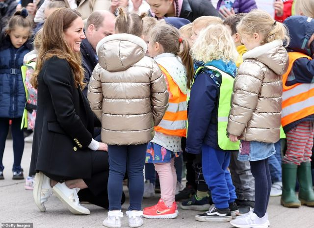 Princess popular: The children crowded around to speak to the Duke and Duchess of Cambridge on their visit to Fife