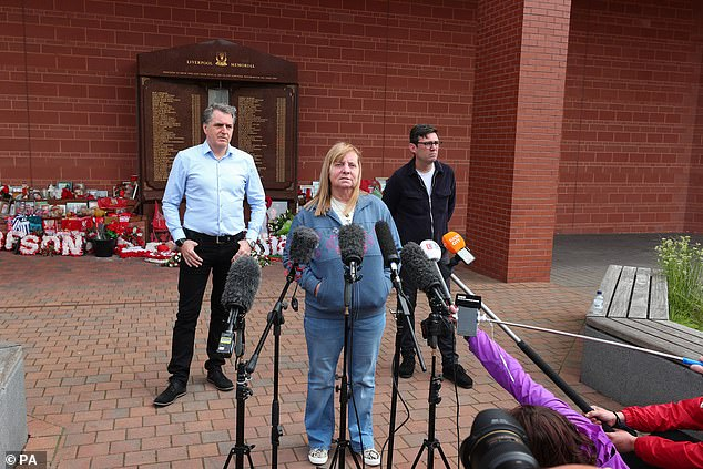 Margaret Aspinall, with Andy Burnham (right), Mayor of Greater Manchester and Steve Rotheram (left), Mayor of Liverpool City Region, outside Anfield Stadium