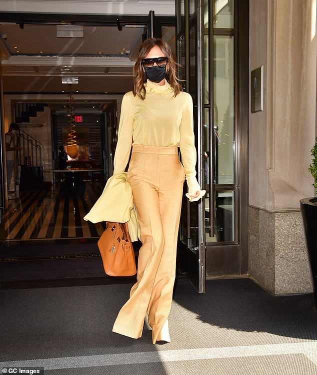 Stunner:She draped a complementary yellow jacket over her arm while also clutching an envy-inducing Hermés Birkin handbag